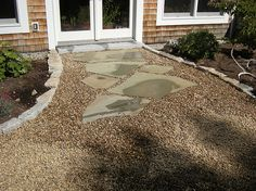 Loose Gravel Patio | Larger size pea stone, or round stone, can also be used for patios and ...