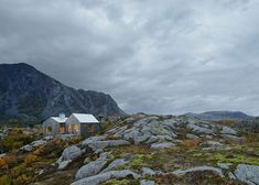 Swedish firm Kolman Boye Architects designed Vega Cottage, a rustic cabin with panoramic views of the surrounding Norwegian Sea and jagged mountain landscape.