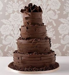 Simple dark chocolate wedding cake. This is probably more like something I will have at my wedding. Dark, chocolatety and good for a fall wedding.