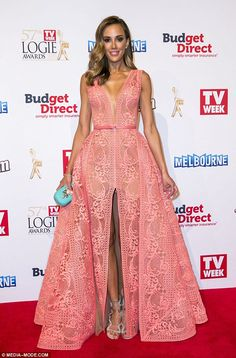 It's a head turner! Rebecca Judd stood out on the red carpet in a lace J'Aton gown featuri...