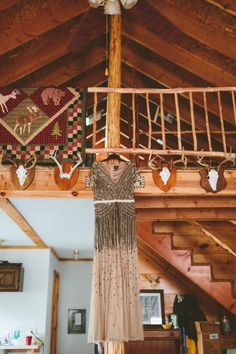 Beth chose a vintage-inspired, nude wedding dress by Adrianna Papell with elaborate beading, sequins and cap sleeves via The Knot, photographed by Shaw Photography Co.