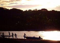 Soccer on the river at sunset - Caraiva, Bahia, Brazil.