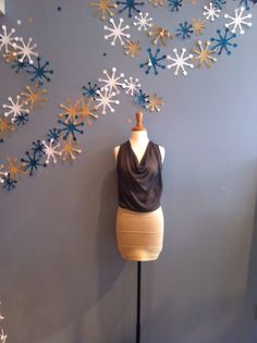 Slvless Glitter Cowl Neck by Ya $54.00 paired with a Gold Sweater Mini Skirt by Ya $48.00