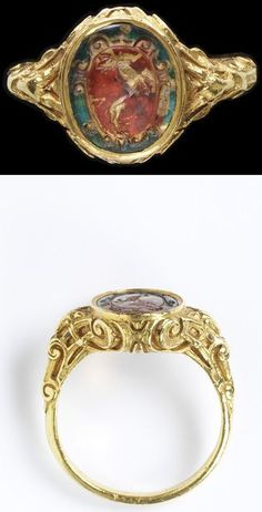 Gold signet ring, formerly enamelled, the oval bezel set with a rock crystal intaglio, reverse painted and gilded, engraved with a coat of arms bordered by scrollwork.