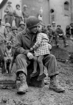 9th Armored Division technician, Alvin Harley, with a little French girl on Valentine's Day, 14 February 1945