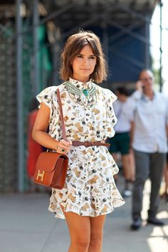 Miroslava Duma rocks her signature statement necklace with a quirky printed dress (image: harpersbazaar)