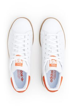 adidas Originals, Stan Smith Sneakers , Unisex, US men's sizing, Perforated logo side accents, Stan Smith logo at tongue, Suede logo accent at collar, Lace-up front, Leather upper, Cushioned textile lining, Contrast gum rubber sole, Imported