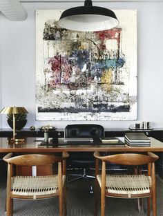 In the offices Andre Mellone shares with his partner, art dealer Andre Viana, Wegner chairs sit opposite an Eames Time-Life chair across an Ico Parisi desk. The desk lamp is by Jo Hammerborg, and the artwork on walls Hugo McCloud.