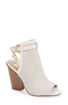 Crisp, white peep-toe booties add a classy touch to any look. The strappy open back makes it perfect for the upcoming months as well!