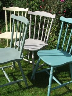 Country style painted wooden chairs in 4 different but complimentary tones.