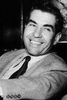 Italian-born gangster Charles 'Lucky' Luciano smiling at the Hotel Excelsior in Rome, 1948.
