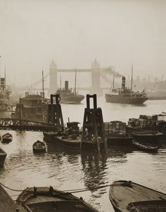 A photograph of the Docks at Tower Bridge in London, England. Taken in the early twentieth century by James Jarché for the Daily Herald. Victorian London, Vintage London, Old London, East London, Victorian Era, London City, London History, British History, Old Pictures