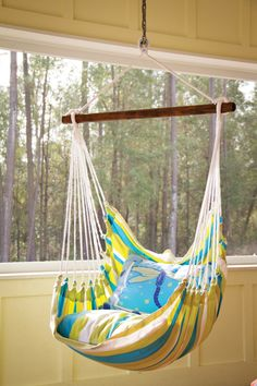 Patio hammock. You could always make this yourself with some wood, fabric and some rope! #sewing #DIY