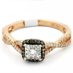 Princess Cut Cognac and White Diamond Engagement Ring - Colorful gemstones collide to make it a rainbow of luxury with this Princess Cut Cognac & White Diamond Engagement Ring in 14K Rose Gold in a Pave setting with a Princess White center stone with White & Cognac Round accent stones on the halo mount & twist shank. The Princess Cut Cognac & White Diamond Engagement Ring has a gem weight of .33 carats with I2-I3 in clarity & I-J in color. The diamonds are 100% natural…