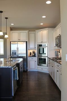 kitchen- cream cabinets with brown glaze -a friend's house has cabinets like these and I've always loved them so much!