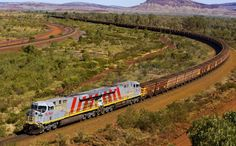 A train carrying iron ore from a Rio Tinto mine in the Pilbara region of Western Australia is seen in this undated handout photograph obtained May Road Trip Destinations, Iconic Australia, Travel Memories, Capital City, Western Australia, Oh The Places You'll Go, Outdoor Camping, Travel Around, Us Travel