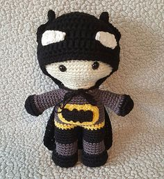 These are the project notes for adapting my Maddy Doll pattern into a Batman doll. The pattern for the logo, hat, and cape are also included.