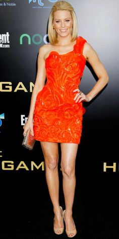 Look of the Day › March 13, 2012 WHAT SHE WORE Banks sizzled at the L.A. The Hunger Games premiere in a tangerine Atelier Versace minidress that she accessorized with Vhernier jewelry, a gold minaudiere and patent leather Jimmy Choo peep-toes.
