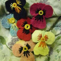 felt pansy, may look more realistic if  you use fabric stiffener to give pansy petals shape and use bleach pen to create more detail.