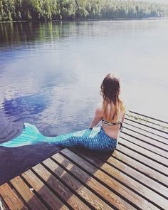 Check out this adorable mermaid in Fin Fun's Tidal Teal Mermaid Tail. Fin Fun Makes swim-able mermaid tails, so you can be a real mermaid too.