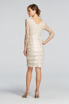 You'll make a stunning mother of the bride or groom in this beautiful dress!  Lace v-neck bodice features 3/4 length illusion sleeves.  Knee length shimmery tiered skirt.  Designed by Adrianna Papell.  Fully lined. Imported. Back zipper.  Machine wash cold. Only non-chlorine bleach. Tumble dry low. Iron if needed. Can be dry cleaned.  To protect your dress, our Non Woven Garment Bag is a must have!