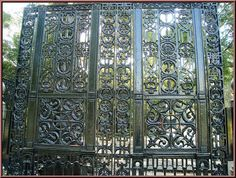 Ornate wrought-iron gates protect the park at night...