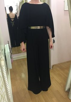 About Me: Black jumpsuit with cape effect to the shoulder, v to the back and gold belt to bring in the waist, pockets to the front and side zip Sizing: True t Occasion Wear, Special Occasion Dresses, Gold Belts, Race Day, Black Jumpsuit, Fashion Boutique, Cape, Party Dress, Bring It On