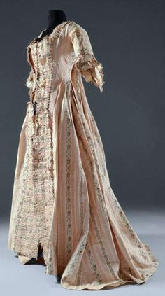 Wedding dress, 1779, France, silk. Mexican polychrome striped silk with  flowered roses. Watteau pleats at back with 18 eyelets lacing for adjustment, sleeves with scalloped ruffles. Coutau-Bégarie