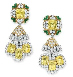 A PAIR OF DIAMOND, YELLOW SAPPHIRE AND EMERALD EAR PENDANTS, BY DAVID WEBB Each suspending a detachable pendant designed as three cushion-cut yellow sapphires within an old European-cut diamond surround, from a detachable circular, old European and baguette-cut diamond link, to the surmount set with a rectangular-cut yellow sapphire within an old European-cut diamond and circular-cut emerald surround, mounted in 18k gold and platinum, circa 1965