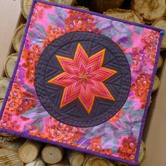 This seems to be the way to go with Folded Star Quilts. You make one big star and then square it up after. I haven't seen a Folded Star quilt with more than one star yet.