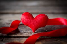 Red heart  with ribbon  on wooden background by Heart Disk - Photo 139586451 / 500px