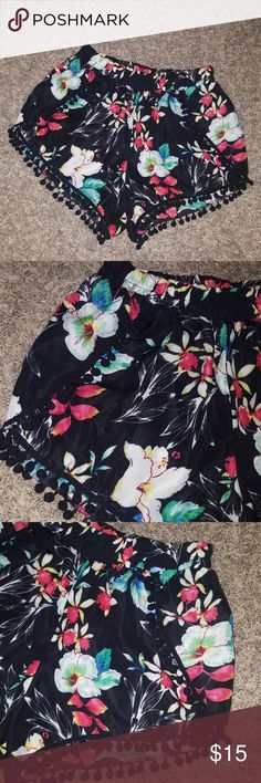 NWOT Festival black floral pom pom shorts Brand new, never worn. Perfect for summer! Boutique Shorts