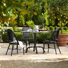 La Coupole Outdoor Dining Table, Round Black Granite Top with Parisian Bistro Chairs from Williams-Sonoma