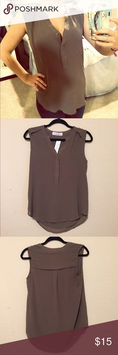 Sleeveless tank Brand new sleeveless tank, NWT. Flattering and perfect for work or an interview. From Stella boutique in Newport Beach, CA Tops Tank Tops