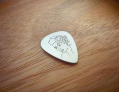This awesome silver pick is inspired by Billie Holiday (1915-1959) and her warm and gentle voice  Made of rhodium plated sterling silver 925  Dimensions: 30mm height, 0.6mm thickness  Our designs of the silver picks are based on famous pictures related to music history  Manufacturing process includes treatment by hand and laser engraving.