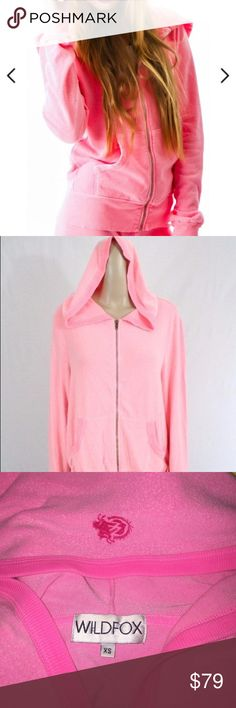 Wildfox Pink Malibu Zip Up Hoodie Logo Sweater XS This is a Super cute Wildfox oversized zip up hoodie. Has the logo on the back of the hood. Size extra small but will definitely fit up to a medium. Malibu pink. Made of 41% rayon 47% polyester 8% spandex. Mint condition. No flaws. Wildfox Sweaters Cardigans