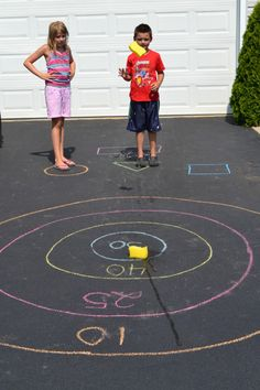 Setting up a target on the pavement for children to practice throwing, counting, and determining distance is an excellent idea for outdoor play.