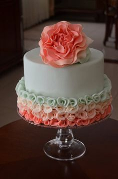 Peony rose-- coral and mint ruffle cake   Have just one or two rows of ruffles on each tier and then the bottom tier has several rows of ruffles