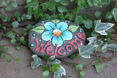 Painted Welcome garden rock decoration, blue flower