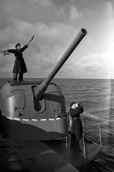 A Russian navy signalman sends a message by means of a flag semaphore.