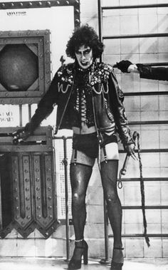 Tim Curry as Dr. Frank-N-Furter activates the Triple Contact Electro Magnet.