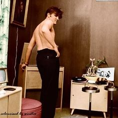 """After his swim, Elvis plays back the acetate of """"Any Way You Want Me"""" to his high school sweetheart, Barbara at 1034 Audubon Drive, July 4, 1956 @Wertheimer"""