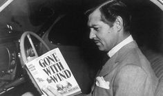 Clark Gable reading Gone With the Wind.