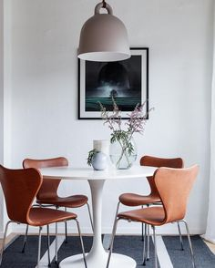 Ikea 'Docksta' tulipe table & leather Arne Jacobsen chairs @behrerochpartners