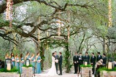 Moss dripped arch surrouned by light strands   Romantic Sacred Oaks at Camp Lucy Texas Wedding Under Lush Oak Trees   Photograph by Al Gawlik Photography  http://storyboardwedding.com/sacred-oaks-at-camp-lucy-texas-wedding/