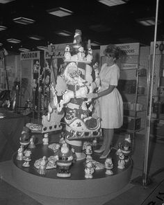 Vintage Christmas Photograph ~ Viviann Frank posing with the Christmas decorations on display at the Poloron booth in the National Housewares Manufacturers Association convention in Chicago, July 10, 1961.