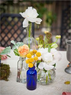 different flowers, different vases. love this idea! | greenleaf images + wedding chicks.