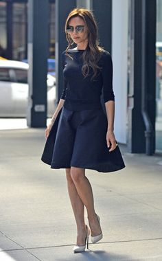 Chic Rewards from Victoria Beckham's Street Style  Once again in one of her own pieces, Victoria steps out in a black number styled with cream pumps.