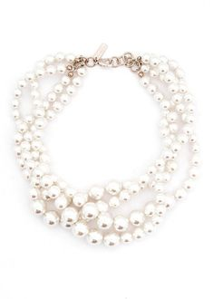Layered pearl necklace.
