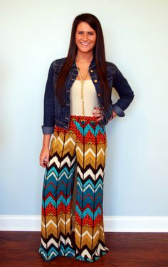These chevron palazzo pants have an elastic waist band, and are very comfortable. Our model is 5'7 and is wearing a medium.